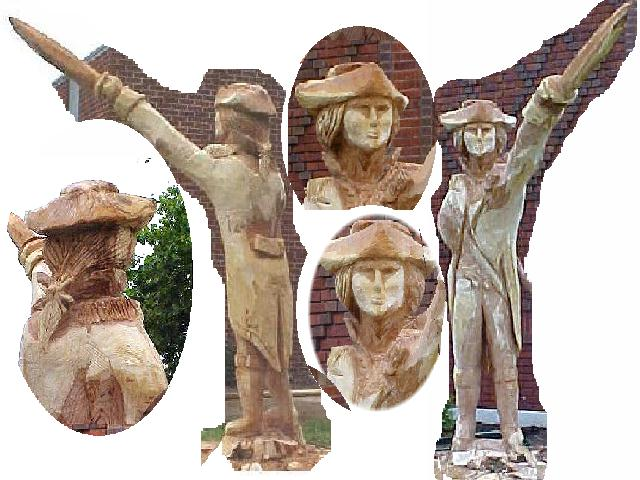 Woodchainsaw carvings in god i trust by kat butler